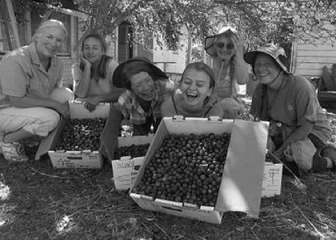 The Grateful Gleaners share a moment at Golden Rule Garden - photo by Ree Slocum